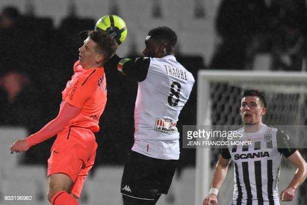 Caen's FrenchIvorian forward Yann Karamoh vies with Angers' Ivorian defender Ismael Traore during the French L1 Football match between Angers and...