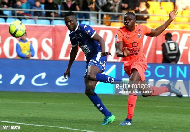 Caen's Haitian defender Romain Genevois vies with Troyes' Malian forward Adama Niane during the French L1 football match between Troyes and Caen on...