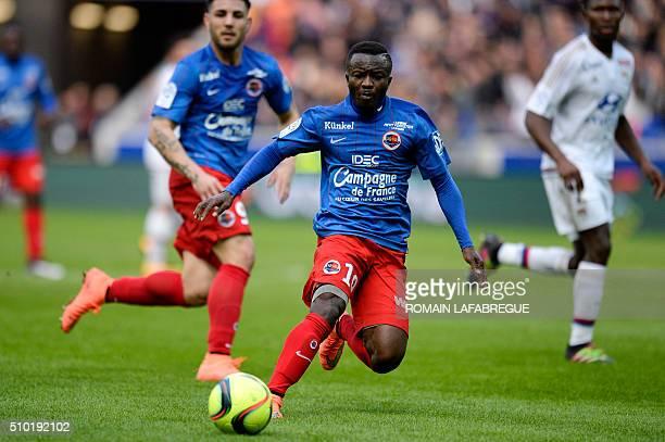 Caens Ivorian forward Christian Kouakou runs with the ball during the French L1 football match between Olympique Lyonnais and Stade Malherbe Caen at...