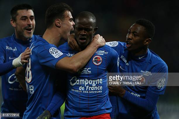 Caen's Ivorian forward Yao Christian Kouakou celebrates with his teammates after scoring a goal during the French L1 football match between Caen and...