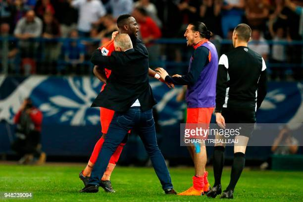 Caen's Ivorian midfielder Ismael Diomande celebrates after scoring with Caen's French head coach Patrice Garande during the French cup semifinal...