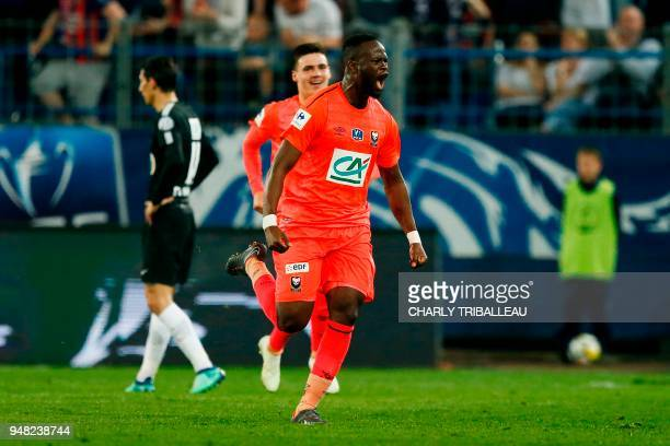 Caen's Ivorian midfielder Ismael Diomande reacts after scoring during the French cup semifinal match between Caen and Paris SaintGermain on April 18...