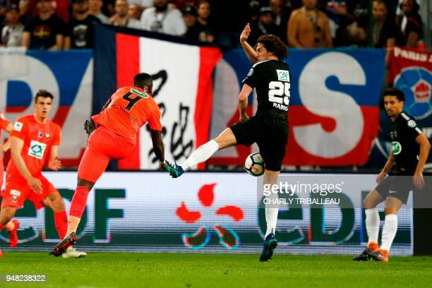 Caen's Ivorian midfielder Ismael Diomande scores during the French cup semifinal match between Caen and Paris SaintGermain on April 18 2018 at the...
