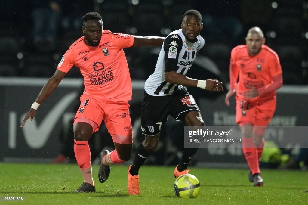 Caen's Ivorian midfielder Ismael Diomande (L) vies with Angers' Cameroonian forward Karl Toko Ekambi (R) during the French L1 football match between Angers (SCO) and Caen (SMC), on March 17, 2018, in Raymond-Kopa Stadium, in Angers, northwestern France. MONIER