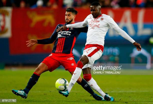 Caen's midfielder Youssef Ait Bennasser vies for the ball with Bordeaux's Senegalese midfielder Younousse Sankhare during the French L1 football...