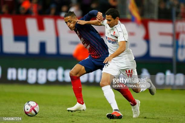 Caen's moroccan forward Yacine Bammou vies with Reims' Brazilian midfielder Ganso during the French L1 football match between Caen and Amiens on...