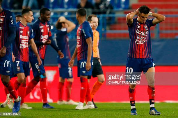Caen's Moroccan midfielder Faycal Fajr and teammates react after being defeated at the end of the French L1 football match between Stade Malherbe...
