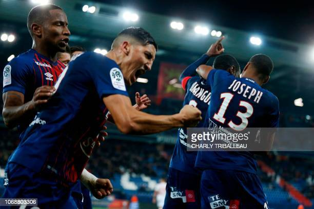 Caen's Moroccan midfielder Faycal Fajr celebrates after the goal scored by Caen's Congolese midfielder Prince Oniangue during the French L1 football...