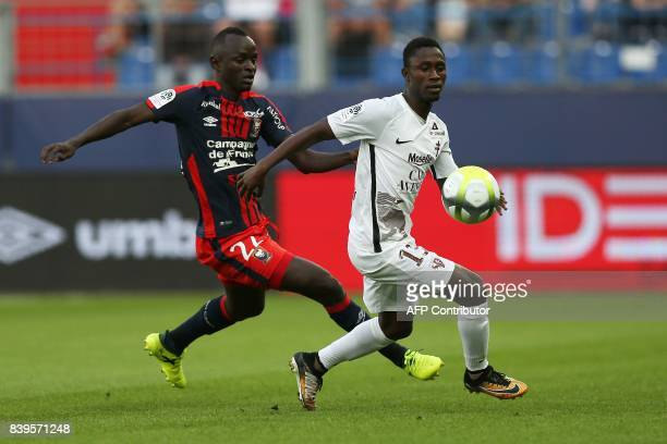 Caen's Senegalese defender Adama Mbengue vies for the ball with Metz' Gambian midfielder Ablie Jallow during the French L1 football match between...
