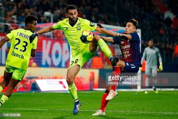 Caen's Tunisian midfielder Saif Eddine Khaoui vies for the ball with Lille's Brazilian midfielder Thiago Maia Alencar during the French L1 football...