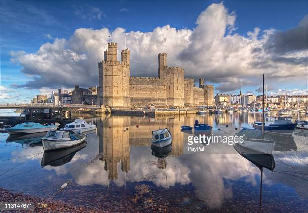 caernarfon castle reflections - castle stock pictures, royalty-free photos & images