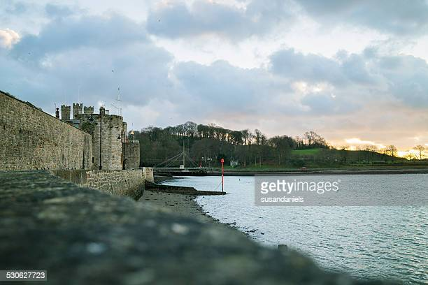 caernarfon castle twilight - menai straits stock pictures, royalty-free photos & images