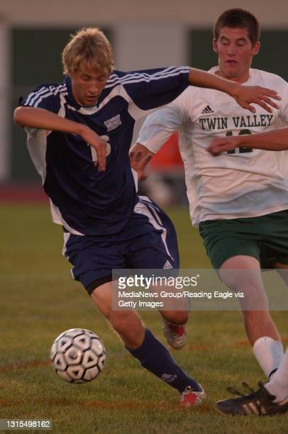 Caernarvon, PA 200502398- Conrad Weiser's Brandon Salvador, #16, and Twin Valley's Kyle Murphy, vie for the ball in the first half of the game at...