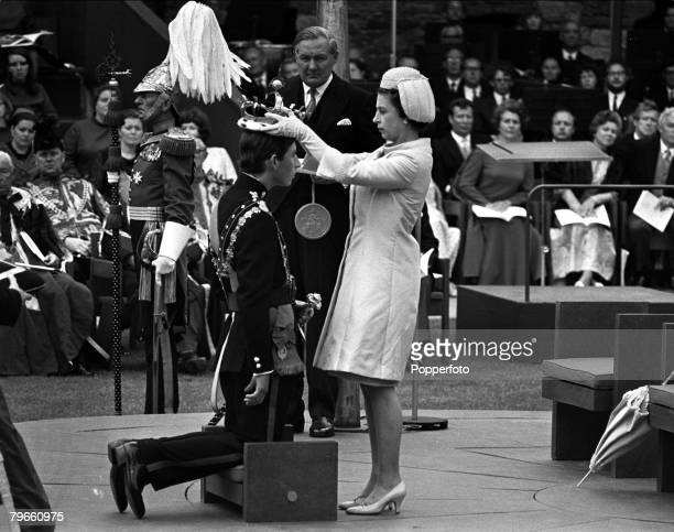 Caernarvon, Wales, 1st July 1969, Queen Elizabeth II of Great Britain places a crown on the head of her 20 year old son Prince Charles at his...