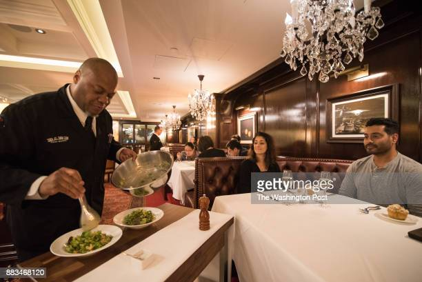 Caesar Salad prepared tableside by Paul Andrew Morton for Gopika Parikh and Murali Kulathungam at Rare Steakhouse in Washington DC on November 27 2017
