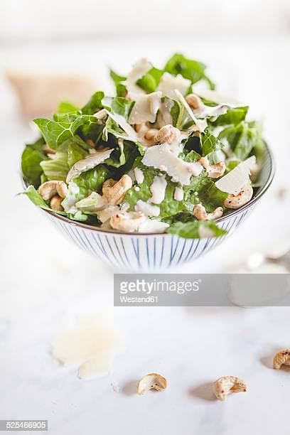 Caesar Salad with roasted cashews in a bowl