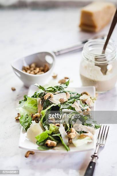 Caesar Salad with roasted cashews on plate