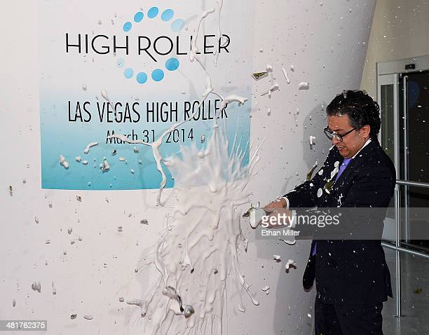 Caesars Entertainment Chief Marketing Officer Tariq Shaukat breaks a bottle of champagne to open the Las Vegas High Roller at The LINQ on March 31...