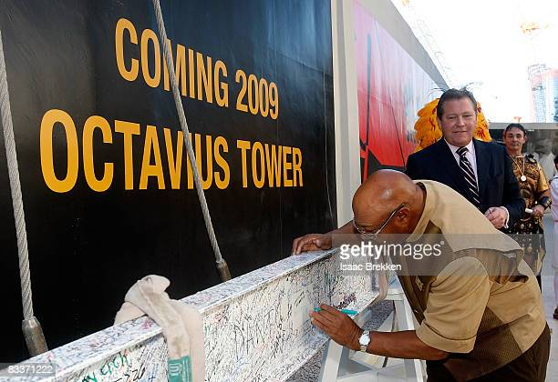 Caesars Palace General Manager John Unwin looks on as Clyde 'Rabbit' Watkins employee since opening day in 1966 signs the final beam of the 23story...