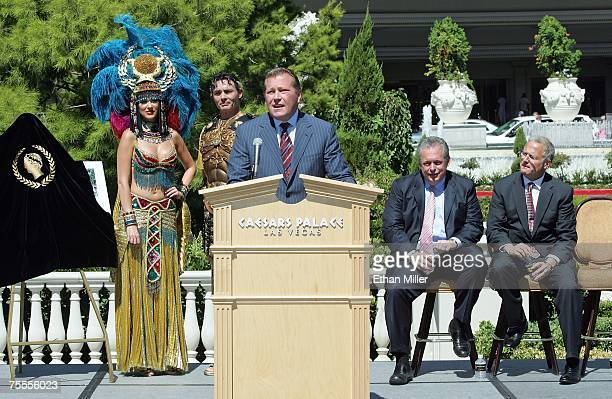 Caesars Palace general manager John Unwin speaks as Roman characters Cleopatra and Julius Caesar and President of Harrah's Entertainment Inc Western...