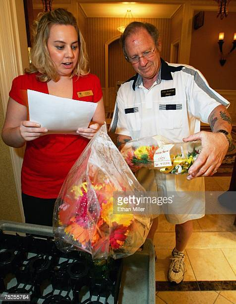Caesars Palace wedding services assistant manager Angela Cooper and Joey Bianchino of Star Flowers go over floral orders for weddings being held...