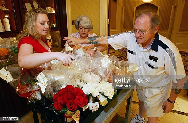 Caesars Palace wedding services assistant manager Angela Cooper Paula McMains and Joey Bianchino of Star Flowers go over floral orders for weddings...