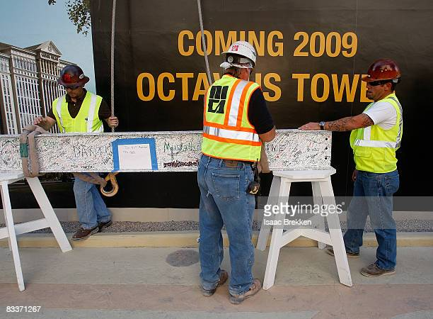 Caesars Palace workers prepare to raise the final beam of the the 23story 665room Octavius Tower at Caesars during a news conference October 21 2008...