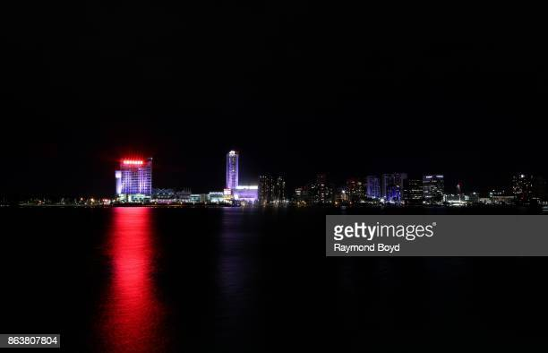 Caesars Windsor Hotel and Casino and Windsor Ontario skyline as photographed from the Detroit Riverwalk in Detroit Michigan on October 13 2017