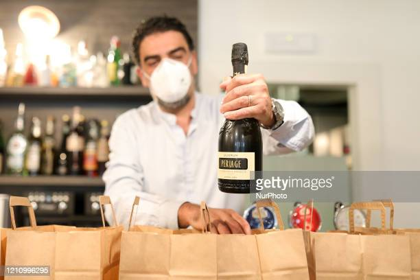Cafè Restaurant and Bar makes vacuum cocktails for home deliveries in compliance to the Covid-19 containment rules during COVID-19 pandemic in Italy...