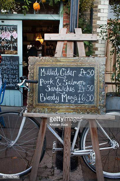 A cafe advertises what's on offer including mulled cider a perfect warm drink on a cold December day Columbia Road flower market is held every Sunday...