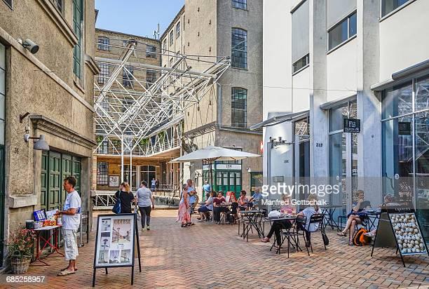 cafe and shops at brandts klaedefabrik - オーデンセ ストックフォトと画像
