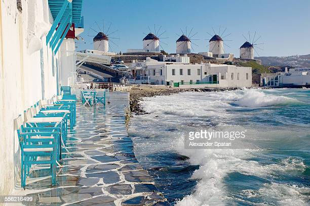cafe and windmills in mykonos, greece - greece stock pictures, royalty-free photos & images