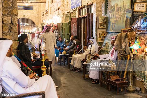 Cafe, Arabic men smoking Sheesha pipes. Doha