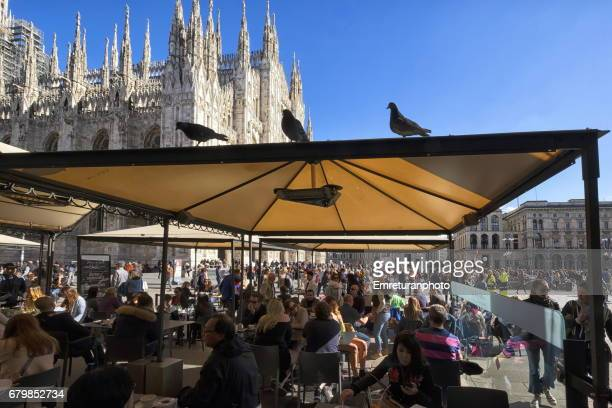 a cafe at duomo square,milan - emreturanphoto stock pictures, royalty-free photos & images