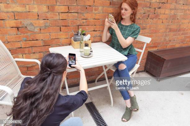 cafe call - lianne loach stock pictures, royalty-free photos & images