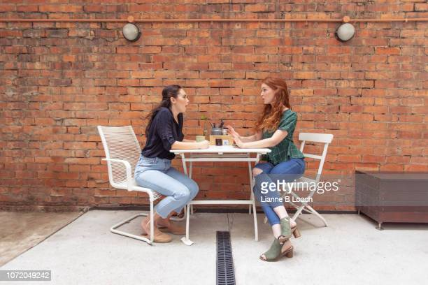 cafe conversation - lianne loach stock pictures, royalty-free photos & images