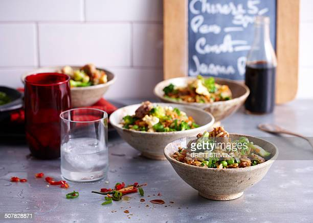 Cafe counter with bowls of fried rice with sausage and egg