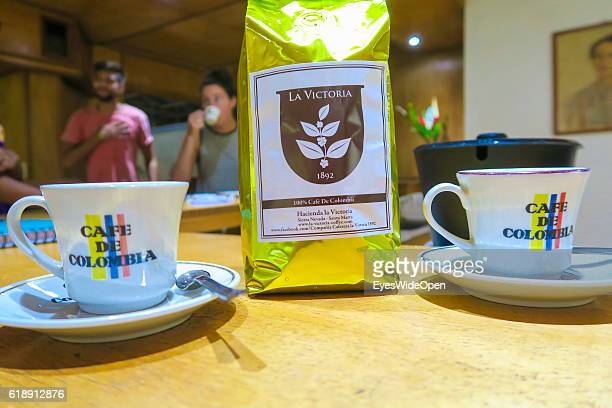 Cafe de Colombia cups and tourists drinking local made coffee at the coffee farm La Victoria on August 19 2016 in Minca Colombia