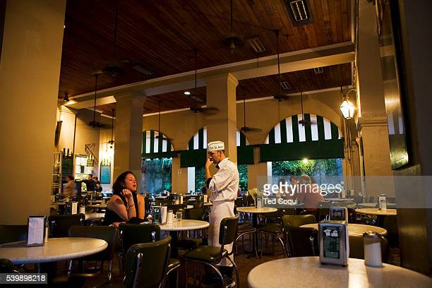Cafe Du Monde a world famous coffee and beignet hangout traditionally busy sits almost empty of its usual customers The tourism business has been...