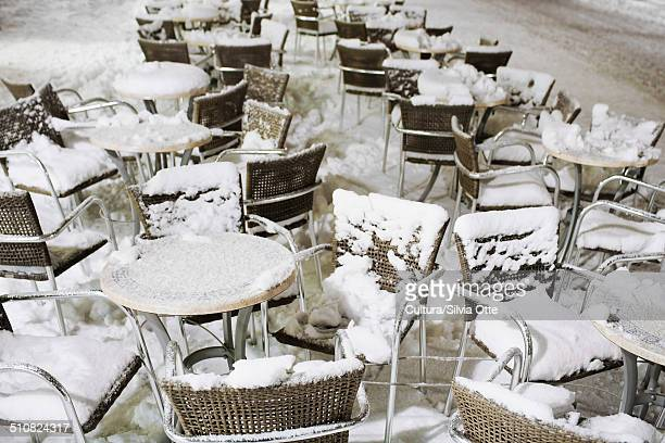 Cafe furniture covered in snow