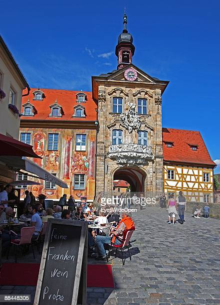 Cafe in front of the former City Hall at the river Regnitz with its facade in rococo style on June 11 2009 in Bamberg Germany Bamberg is listed as a...