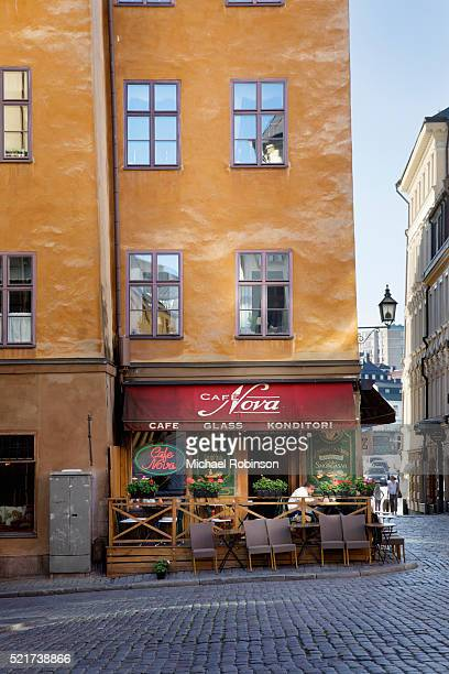 cafe in gamla stan in stockholm sweden - michael robinson stock pictures, royalty-free photos & images