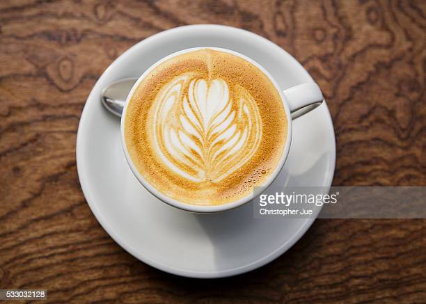 A cafe latte is seen on a table at a local specialty coffee shop on May 20 2016 in Tokyo Japan With the rise of specialty coffee shops opening all...