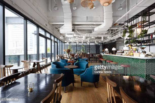 cafe lounge in a co-working office - catering building stock pictures, royalty-free photos & images