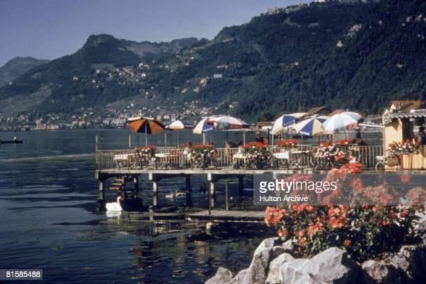 A cafe on the water in Villeneuve on Lake Geneva Switzerland circa 1960