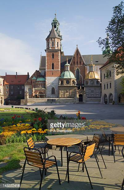 cafe overlooking wawel cathedral, wawel hill, krakow, poland - wawel cathedral stock pictures, royalty-free photos & images