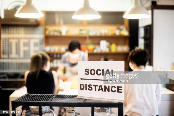 cafe reopens for business according to new rules - covid-19 ストックフォトと画像