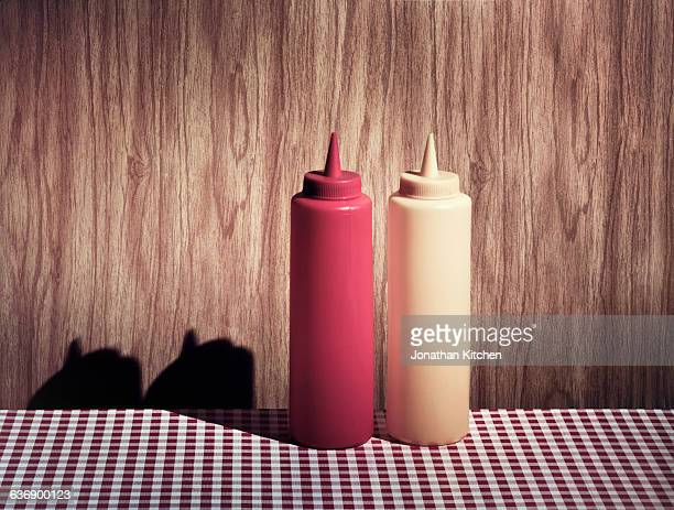 cafe scene of ketchup and mustard - two objects stock photos and pictures