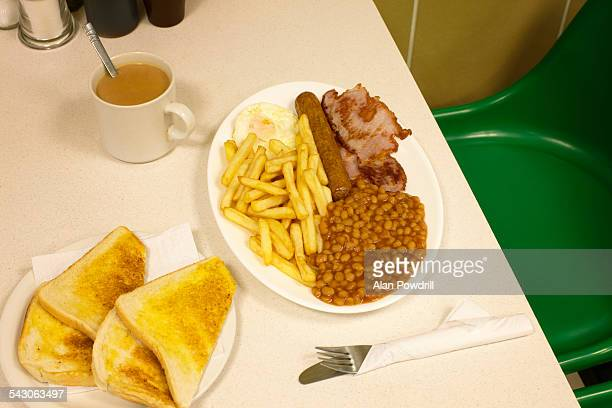 Cafe table top with fried breakfast