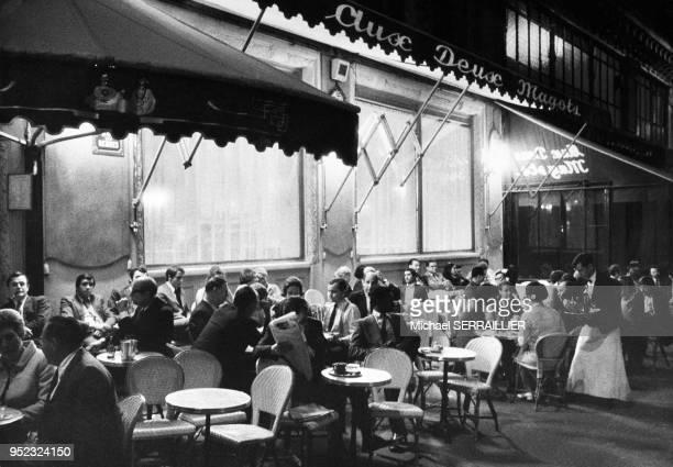 Cafe terrace Aux Deux Magots in the evening at Saint Germain des Pres, Paris, 6th district, France in 1969.